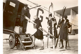 Women board aircraft with skis