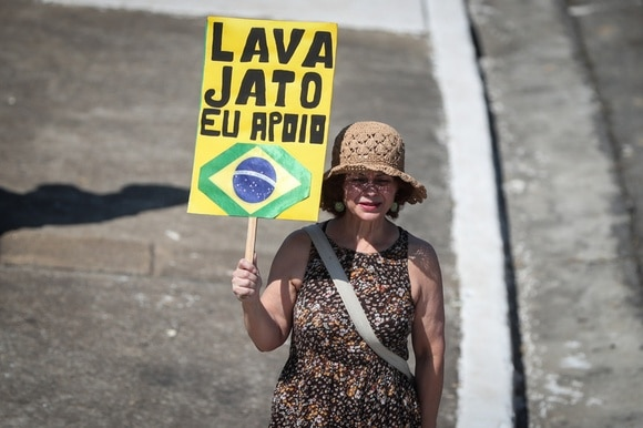A woman holds a placard during a rally in Sao Paulo, Brazil.
