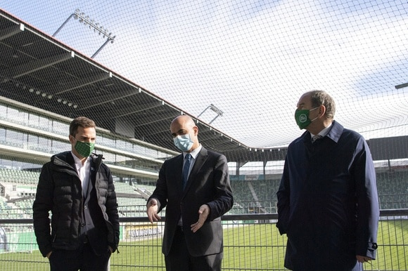 Interior MInister Berset with two other men inside the St Gallen football stadium
