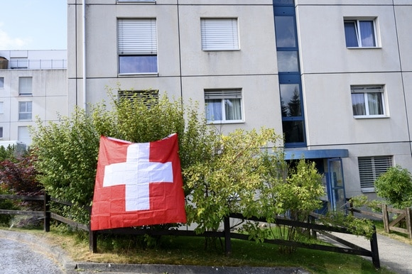house with Swiss flag