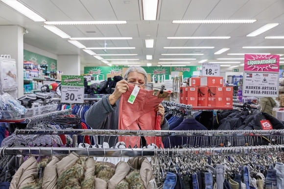 An elderly woman shopping for clothing