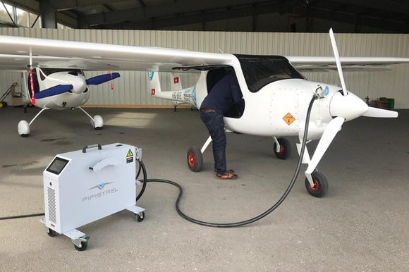 Man looking inside electric plane.