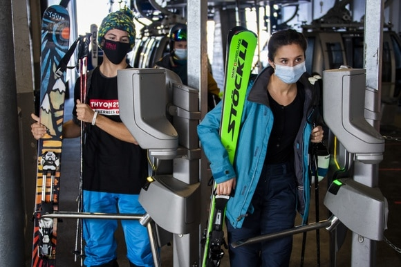 skiers in masks