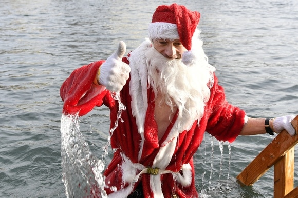 Father Christmas in a lake