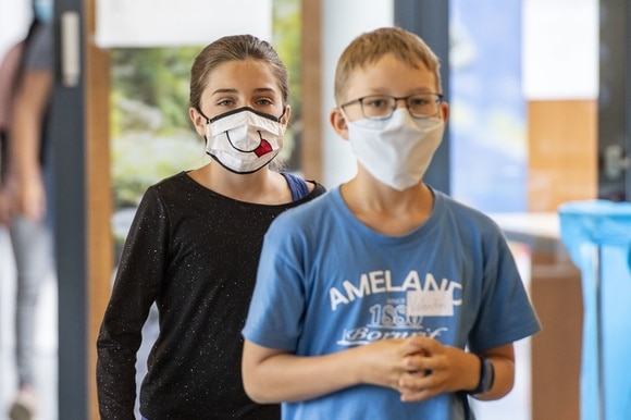 Two pupils wearing masks