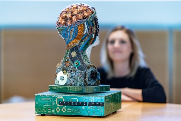 A sculpture of a head made of electronic components.