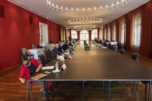 People sitting a long conference table