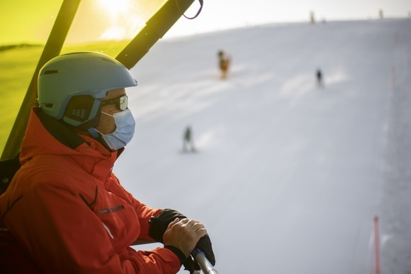A skier on a lift in Davos on October 25, 2020.