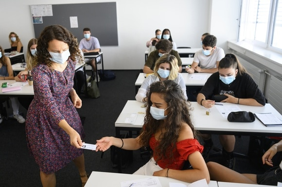 school teacher and pupil in masks