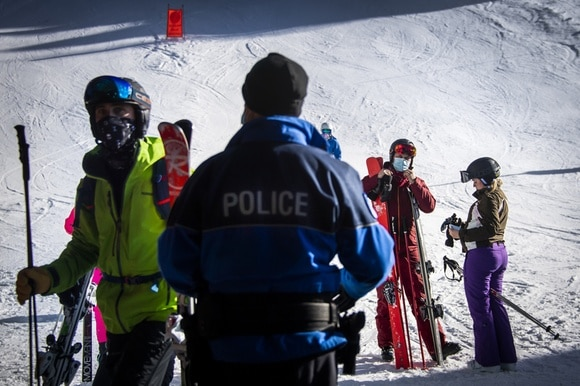 Policeman checking skiers