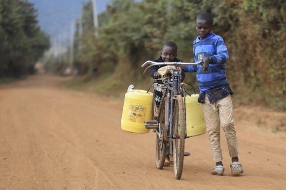 Two African boys collecting water