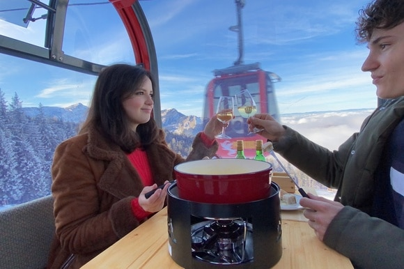 Sharing a fondue in a cable car