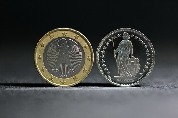 Dollar and franc coins