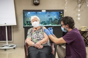 Old woman getting vaccinated