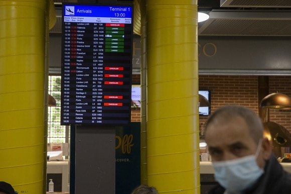 Screens are listing the cancelled flights between Switzerland and Britain