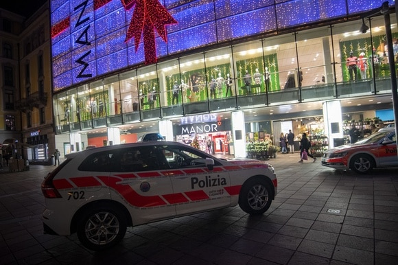 Police cars outside a shop