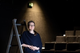 young woman in theatre