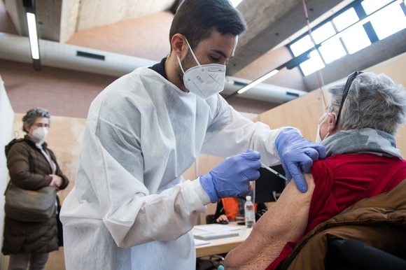 An elderly woman gets vaccinated against Covid-19 at a centre in Rivera, canton Ticino, on January 12, 2020.