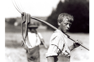Boy with hay fork