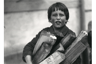 Child carrying wood