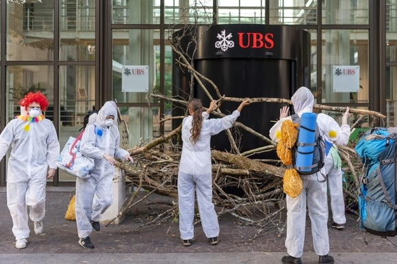 activists protesting outside UBS in 2019