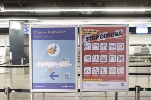 Two posters for Covid tests at an airport