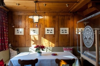 Dining room with paper cuts on walls