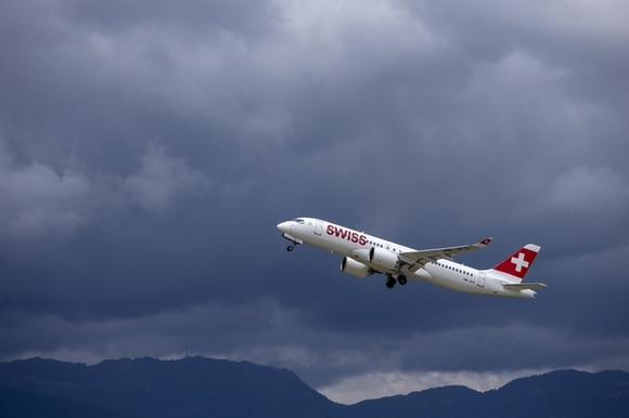 Swiss plane over Geneva Airport.