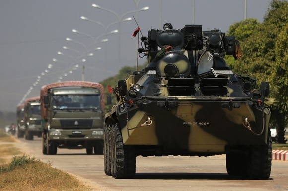 Military vehicles and soldiers patrol a road in Naypyitaw, Myanmar
