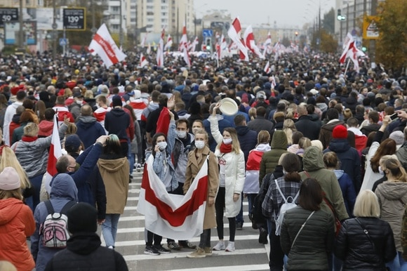 Demonstrators with Belarus flag in street
