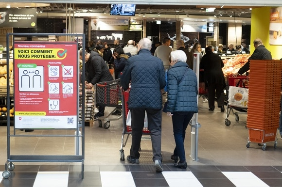 Shoppers entering a supermarket