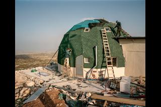 Ein grünes Haus wird gebaut
