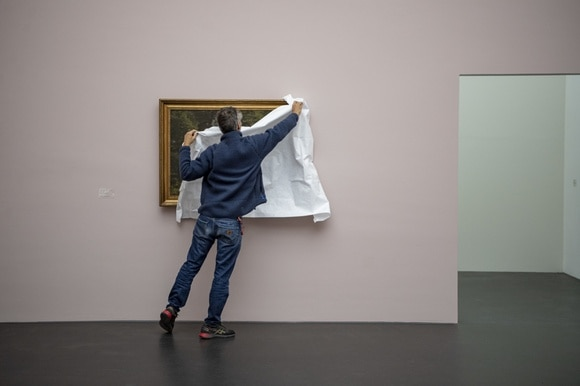 Man unveiling painting