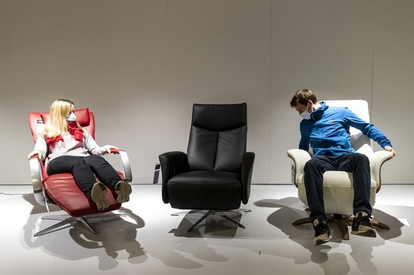 Customers test armchairs at Pfister furniture store in Dübendörf