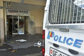 Police van and broken glass door