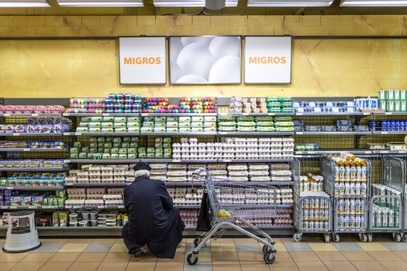 Man shopping for eggs in a supermarket