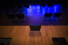 Stage and empty chairs