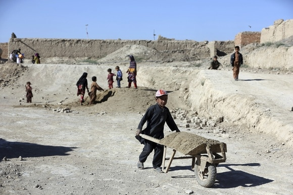 Afghan children working on a construction site