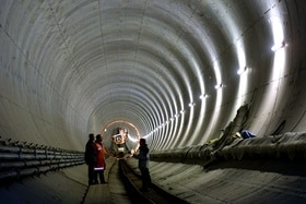 People on construction site in tunnel