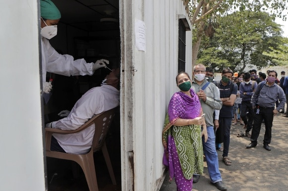 Citizens of India line up for a nasal swab.
