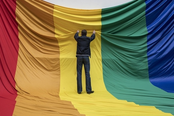 Man puts up LGBTQ flag