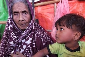 Solima Khatun, a 120 year old refugee with young child