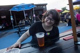 Nina drinking a beer