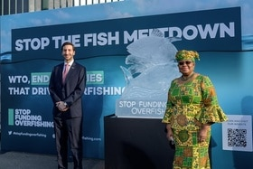 WTO Director-General and the Chair of the fisheries subsidies negotiations in front of an ice sculpture