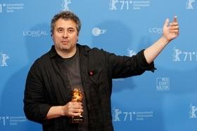 Radu Jude receiving the Golden Lion in Berlin