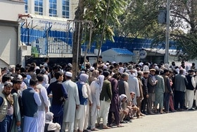 People in Kabul line up at ATM bank machine